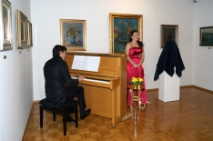 Performing at the opening of exhibition dedicated to the passed away diva Vilma Bukovec at Metlika